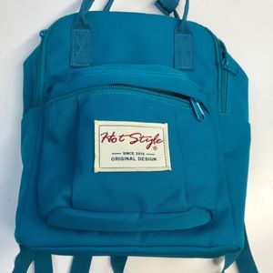 New turquoise backpack. Lot of pockets in & out !